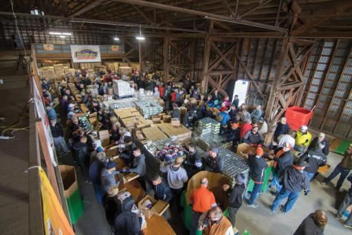 Hundreds of people gathered at Mountaire's Selbyville warehouse on Monday, Nov. 19, to pack 8,500 boxes of Thanksgiving meals for people in the community.