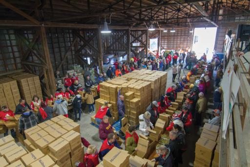 Volunteers packed the Mountaire Farms location in Selbyville on Monday, Nov. 25, to help families in need for the holidays.