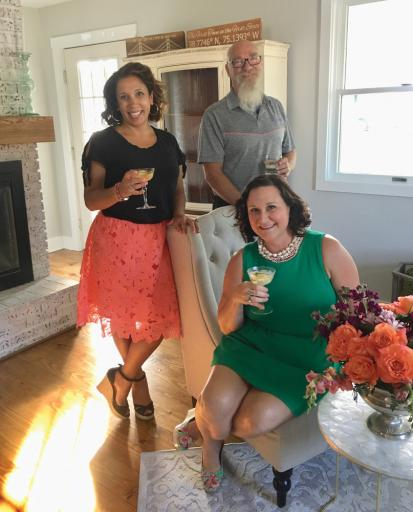 Carly Miller, co-owner of Styled, left, celebrates the business' merger with Jim Gray of The City Florist, center, and Jess Bain, co-owner of Styled, right.