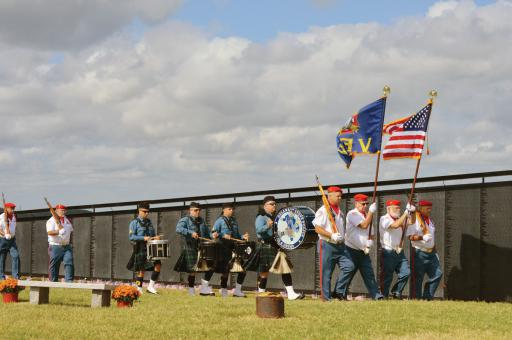 VFW color guard members, accompanied by members of the Delaware State Police Fife & Drum Corps, march by The Wall That Heals during a ceremony on Saturday, Oct. 5, at Mason-Dixon Post 7234 in Ocean View. For more, see the photo page in this week's issue.