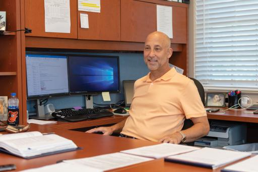 The Town of Ocean View's new P&Z director Ken Cimino sits at his desk.
