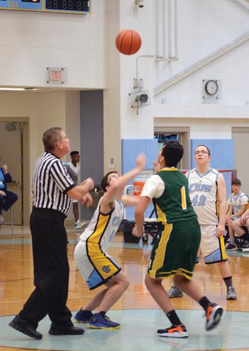 IR freshman Gabe Mouynivong goes up for the opening jump ball during the Indians' game against Cape Henlopen on Thursday, Jan. 24. IR won the game 19-14 for the program's first win in just their second game.