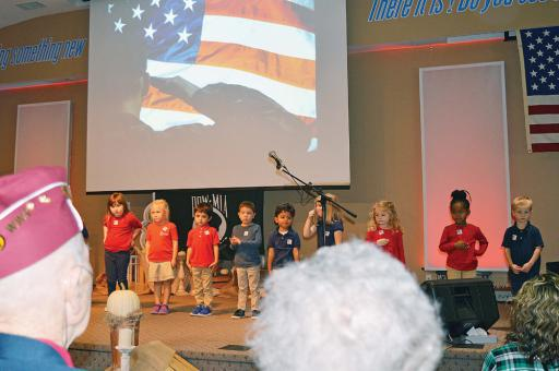 Students of Lighthouse Christian pay homage to visiting veterans in a previous event.