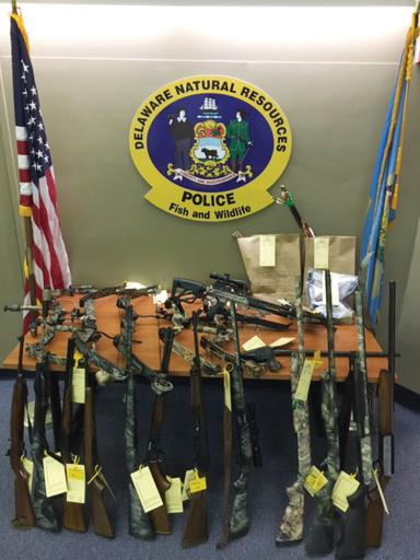 Guns, bows, knives and ammunition are among the evidence seized in the Dec. 11 arrests of two Millsboro men on charges related to alleged weapons and poaching violations.