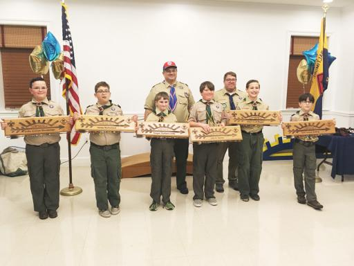 Webelos 2 Den leader & Assistant Cub Scout Master Brendan Crotty and Cub Master David Kittell pose with members Keagan Crotty, Colin Shoobridge, Aiden Magee, Jake Garner, Tyler Netting and James Mulholland as they display their Arrows of Light.