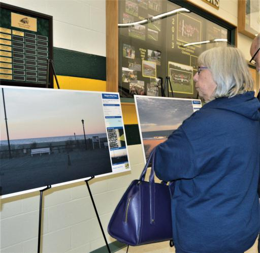 Maxine Meyer of Ocean View examines a rendering of what proposed wind turbines would look like from the Bethany Beach boardwalk following an informational meeting at Indian River High School on Tuesday, Nov. 19.