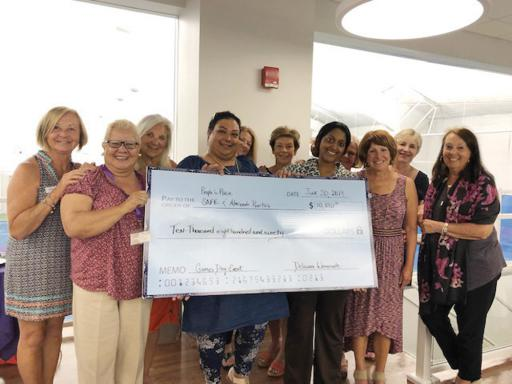 Members of the Delaware Womenade gathered to donate a check to People's Place staff on Thursday, June 21.