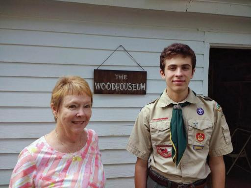 Barbara Slavin and Carter McCabe pose in front of the Woodhouseum.